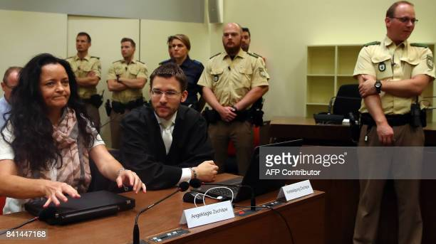 Defendant Beate Zschaepe accused of helping to found a neoNazi cell called the National Socialist Underground sits next to her lawyer Mathias Grasel...