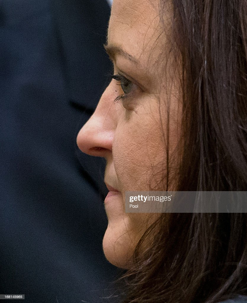Defendant Beate Zschaepe arrives in court on the first day of the NSU neo-Nazi murder trial on May 6, 2013 in Munich, Germany. The main defendant, Beate Zschaepe, is on trial for her role in assisting Uwe Boehnhardt and Uwe Mundlos in the murder of nine immigrants and one policewoman across Germany between 2000 and 2007, and four other co-defendants, including Ralf Wohlleben, Holder G., Carsten S. and Andre E., are accused of assisting the trio. Zschaepe, Mundlos and Boehnhardt lived together for years undetected by police and called themselves the National Socialist Underground, or NSU. The case only came to light after Mundlos and Boehnhardt committed suicide after the two were cornered by police following a bank robbery in 2011.
