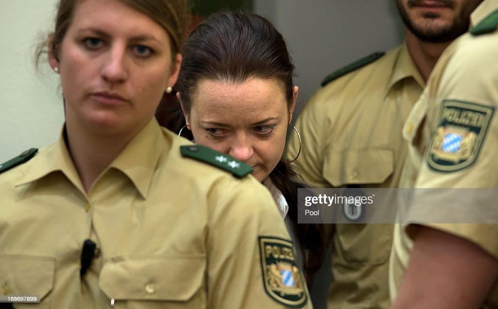 Defendant <a gi-track='captionPersonalityLinkClicked' href=/galleries/search?phrase=Beate+Zschaepe&family=editorial&specificpeople=8630982 ng-click='$event.stopPropagation()'>Beate Zschaepe</a> arrives in court on the second day of the NSU neo-Nazi murder trial on May 14, 2013 in Munich, Germany. Zschaepe is the main defendant and is on trial for her role in assisting Uwe Boehnhardt and Uwe Mundlos in the murder of nine immigrants and one policewoman across Germany between 2000 and 2007. Four other co-defendants, including Ralf Wohlleben, Holder G., Carsten S. and Andre E., are accused of assisting the trio. Zschaepe, Mundlos and Boehnhardt lived together for years undetected by police and called themselves the National Socialist Underground, or NSU. The case only came to light after Mundlos and Boehnhardt committed suicide after the two were cornered by police following a bank robbery in 2011.