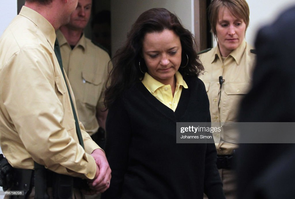 Defendant <a gi-track='captionPersonalityLinkClicked' href=/galleries/search?phrase=Beate+Zschaepe&family=editorial&specificpeople=8630982 ng-click='$event.stopPropagation()'>Beate Zschaepe</a> (C) arrives in the courtroom on day three of the NSU neo-Nazis murder trial at the Oberlandgericht Muenchen court on May 15, 2013 in Munich, Germany. Zschaepe is the main defendant and is on trial for her role in assisting Uwe Boehnhardt and Uwe Mundlos in the murder of nine immigrants and one policewoman across Germany between 2000 and 2007. Together the trio called themselves the NSU, or National Socialist Underground. Four other co-defendants, including Ralf Wohlleben, Holder G., Carsten S. and Andre E., are accused of assisting the trio. Zschaepe has thus far remained silent and has refused to answer any questions by the court, including when asked to state her name.