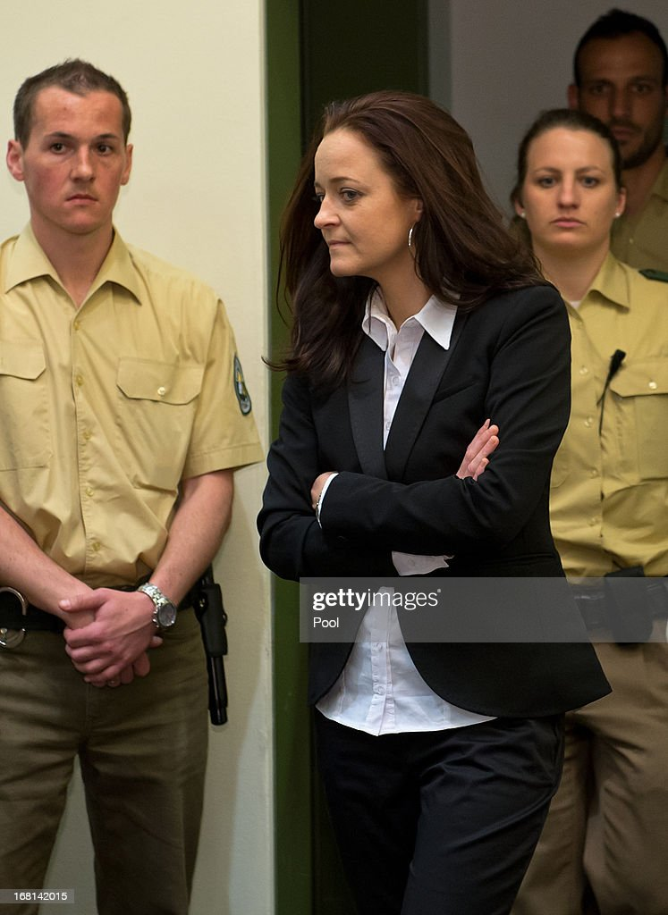 Defendant Beate Zschaepe enters court with law enforcement officers on the first day of the NSU neo-Nazi murder trial on May 6, 2013 in Munich, Germany. The main defendant, Beate Zschaepe, is on trial for her role in assisting Uwe Boehnhardt and Uwe Mundlos in the murder of nine immigrants and one policewoman across Germany between 2000 and 2007, and four other co-defendants, including Ralf Wohlleben, Holder G., Carsten S. and Andre E., are accused of assisting the trio. Zschaepe, Mundlos and Boehnhardt lived together for years undetected by police and called themselves the National Socialist Underground, or NSU. The case only came to light after Mundlos and Boehnhardt committed suicide after the two were cornered by police following a bank robbery in 2011.