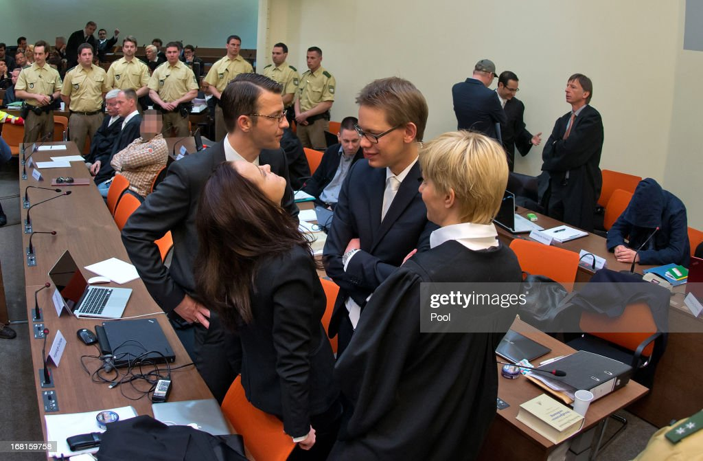 Defendant Beate Zschaepe stands in court with her legal team, lawyers <a gi-track='captionPersonalityLinkClicked' href=/galleries/search?phrase=Wolfgang+Heer+-+Advogado&family=editorial&specificpeople=14887066 ng-click='$event.stopPropagation()'>Wolfgang Heer</a>, <a gi-track='captionPersonalityLinkClicked' href=/galleries/search?phrase=Anja+Sturm&family=editorial&specificpeople=10879931 ng-click='$event.stopPropagation()'>Anja Sturm</a> and <a gi-track='captionPersonalityLinkClicked' href=/galleries/search?phrase=Wolfgang+Stahl&family=editorial&specificpeople=654884 ng-click='$event.stopPropagation()'>Wolfgang Stahl</a>, on the first day of the NSU neo-Nazi murder trial on May 6, 2013 in Munich, Germany. The main defendant, Beate Zschaepe, is on trial for her role in assisting Uwe Boehnhardt and Uwe Mundlos in the murder of nine immigrants and one policewoman across Germany between 2000 and 2007, and four other co-defendants, including Ralf Wohlleben, Holder G., Carsten S. and Andre E., are accused of assisting the trio. Zschaepe, Mundlos and Boehnhardt lived together for years undetected by police and called themselves the National Socialist Underground, or NSU. The case only came to light after Mundlos and Boehnhardt committed suicide after the two were cornered by police following a bank robbery in 2011.