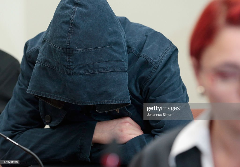 Defendant Carsten S. hides behind a hood prior to the trial during day 18 of the NSU neo-Nazis murder trial at the Oberlandgericht Muenchen court on July 3, 2013 in Munich, Germany. Beate Zschaepe is the main defendant and is on trial for her role in assisting Uwe Boehnhardt and Uwe Mundlos in the murder of nine immigrants and one policewoman across Germany between 2000 and 2007. Together the trio called themselves the NSU, or National Socialist Underground, and were able to operate unbeknownst to police until Mundlos and Boehnhardt were cornered in 2011 after the two robbed a bank. Four other co-defendants, including Ralf Wohlleben, Holder G., Carsten S. and Andre E., are accused of assisting the trio. Carsten S. and Holger G. have declared themselves willing to give limited testimonies, while Zschaepe has thus far remained silent and refuses to answer any questions by the court.