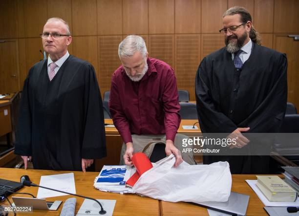 Defendant Daniel M is flanked by his lawyers Hannes Linke and Robert Kain as he arrives for the opening of his trial at court in Frankfurt am Main...