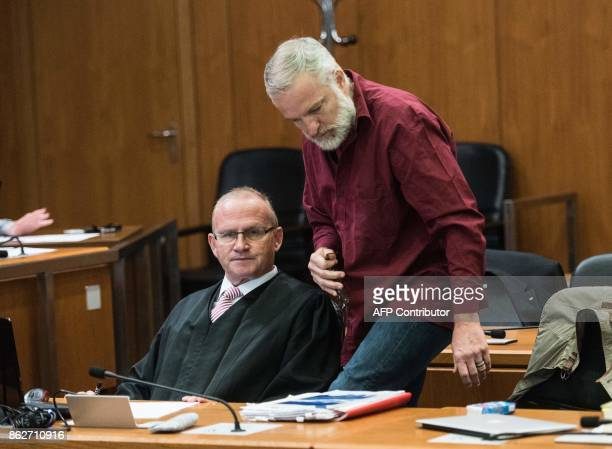 Defendant Daniel M talks with his lawyer Hannes Linke as he arrives for the opening of his trial at court in Frankfurt am Main western Germany on...