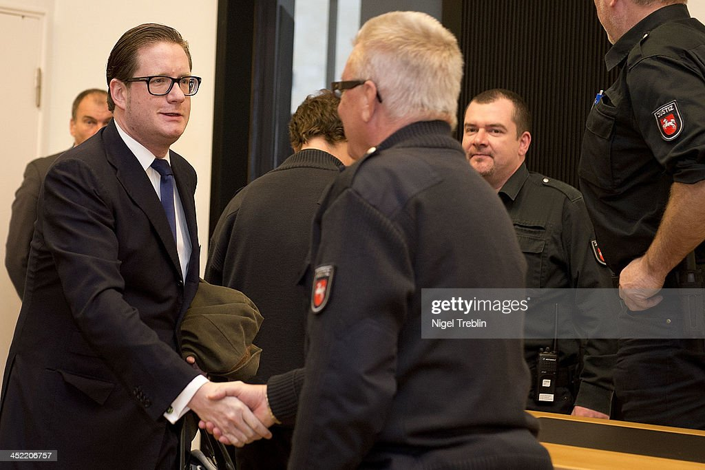 Defendant David Groenewold greets a judicial officer in the courtroom at the Landgericht Hannover courthouse for the third day of his trial on November 27, 2013 in Hanover, Germany. Wulff is accused of accepting favors while he was governor of Lower Saxony, a charge that prompted him to resign last year from his office as president. Wulff is the first post-World War II German president to face a court trial.