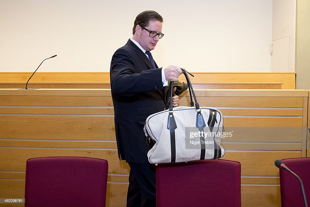 Defendant David Groenewold waits in the courtroom at the Landgericht Hannover courthouse for the third day of his trial on November 27, 2013 in Hanover, Germany. Wulff is accused of accepting favors while he was governor of Lower Saxony, a charge that prompted him to resign last year from his office as president. Wulff is the first post-World War II German president to face a court trial.