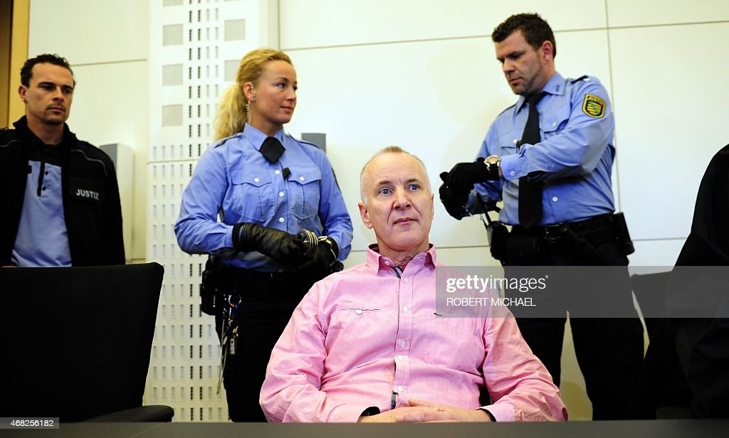 Defendant Detlev G a former police officer accused of murdering a willing victim he met on a website for cannibalism fetishists waits for his trial...