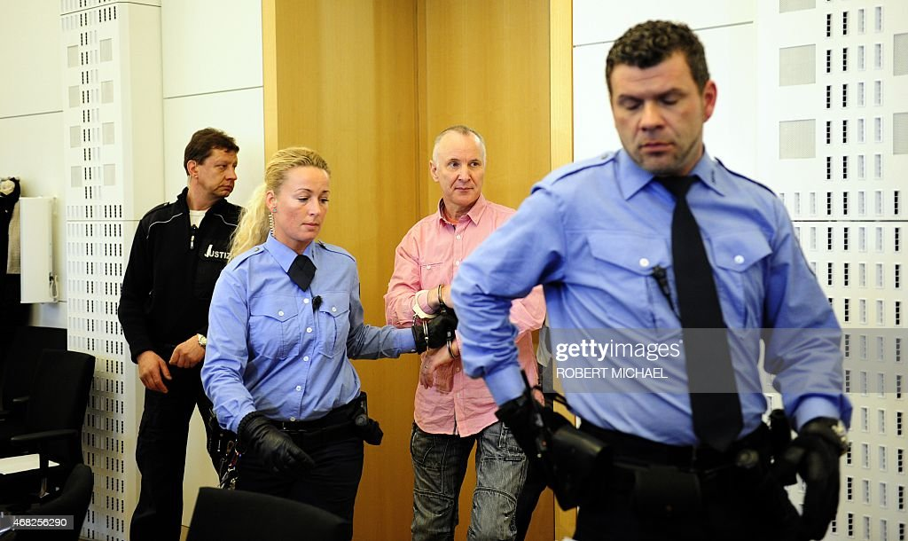 Defendant Detlev G a former police officer accused of murdering a willing victim he met on a website for cannibalism fetishists arrives for his trial...
