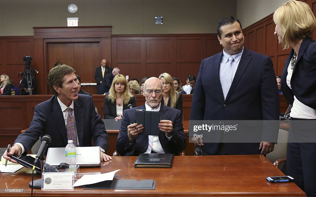 Defendant George Zimmerman (2nd R) smiles while standing with his attorneys Mark O' Mara (L), Don West (2nd L) and Lorna Truett during his murder trial July 12, 2013 in Sanford, Florida. Judge Debra Nelson has ruled that the jury can also consider a lesser manslaughter charge along with the second-degree murder charge in the shooting death of Trayvon Martin.