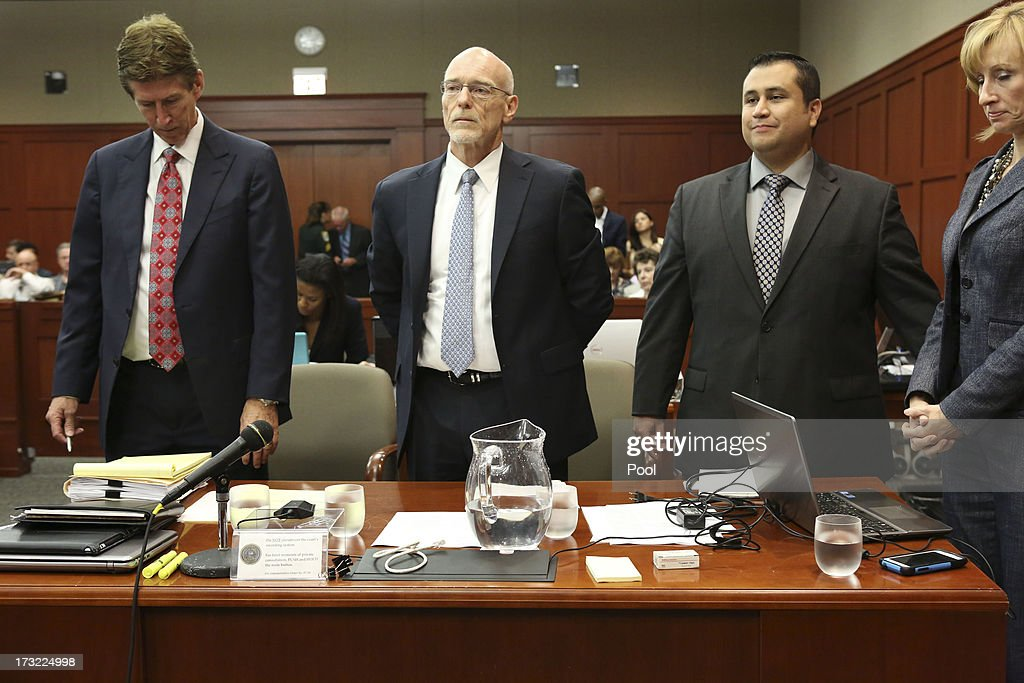 Defendant George Zimmerman (2nd R) stands with his defense counsel Mark O'Mara (L) Don West, (2nd L) and Lorna Truett during his murder trial during his murder trial July 10, 2013 in Sanford, Florida. Zimmerman has been charged with second-degree murder for the 2012 shooting death of Trayvon Martin.