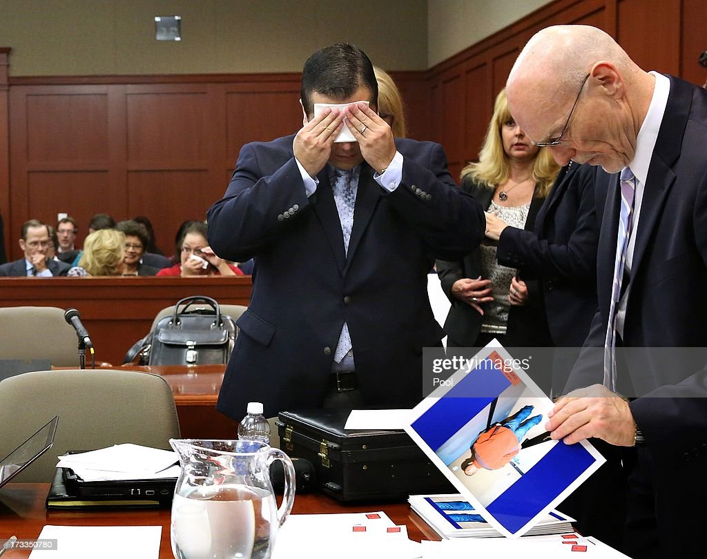 Defendant George Zimmerman (L) wipes his face after arriving in the courtroom for closing aurguments in his murder trial as defense counsel Don West stands nearby July 12, 2013 in Sanford, Florida. Judge Debra Nelson has ruled that the jury can also consider a lesser manslaughter charge along with the second-degree murder charge in the shooting death of Trayvon Martin.