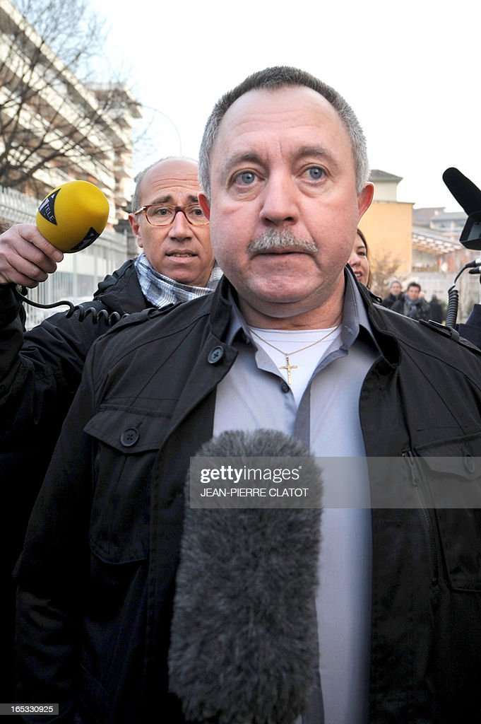 Defendant Jean-Jacques Prost (C), who was driving a school bus that was hit on June 2, 2008 by a train on a railway crossing in the eastern French town of Allinges, arrives on April 3, 2013 at the courthouse for the opening of his trial in the Alpine city of Thonon-les-Bains. Prost, the state-owned railway company SNCF and rail operator Reseau Ferre de France are charged with involuntary homicides after a train hit the school bus carrying teenagers, killing seven students and wounding 25. One of the teachers, who survived the crash, later committed suicide. AFP PHOTO / JEAN-PIERRE CLATOT
