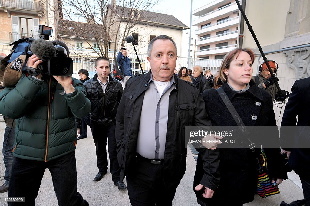 Defendant Jean-Jacques Prost (C), who was driving a school bus that was hit on June 2, 2008 by a train on a railway crossing in the eastern French town of Allinges, arrives on April 3, 2013 with unidentified relatives at the courthouse for the opening of his trial in the Alpine city of Thonon-les-Bains. Prost, the state-owned railway company SNCF and rail operator Reseau Ferre de France are charged with involuntary homicides after a train hit the school bus carrying teenagers, killing seven students and wounding 25. One of the teachers, who survived the crash, later committed suicide.