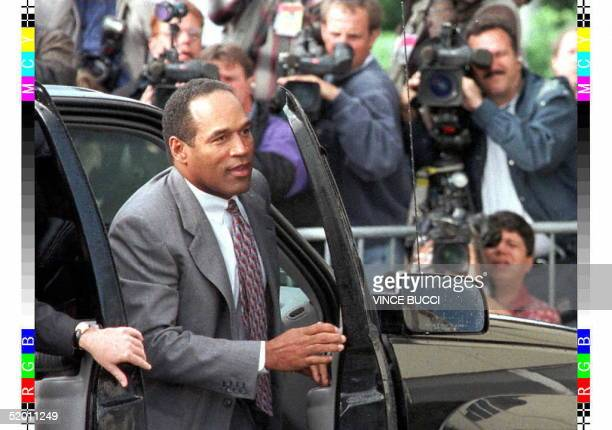 Defendant OJ Simpson exits his car 22 November outside the courthouse in Santa Monica CA Simpson took the witness stand in the wrongful death lawsuit...