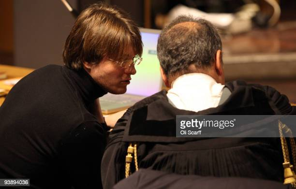 Defendant Raffaele Sollecito speaks to his lawyer on the final day of the Meredith Kercher murder trial on December 4 2009 in Perugia Italy Amanda...