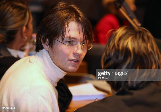 Defendant Raffaele Sollecito speaks to his lawyer prior to the closing arguments of the Meredith Kercher Trial on December 3 2009 in Perugia Italy...
