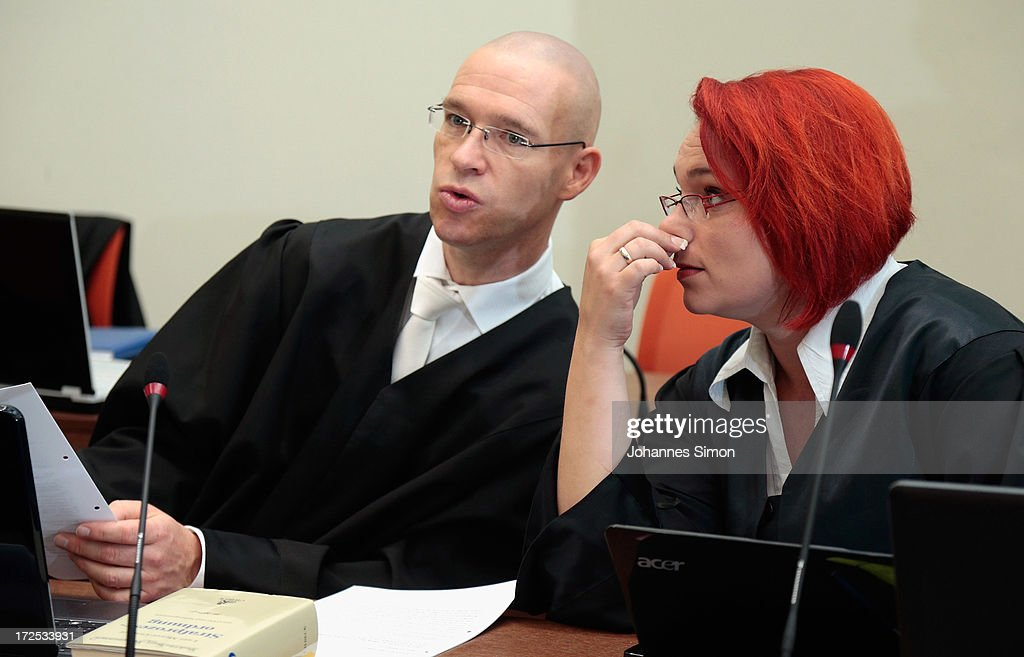 Defendant Ralf Wohlleben's lawyers Olaf Klemke (L) and Nicole Schneiders chat prior to the trial during day 18 of the NSU neo-Nazis murder trial at the Oberlandgericht Muenchen court on July 3, 2013 in Munich, Germany. Beate Zschaepe is the main defendant and is on trial for her role in assisting Uwe Boehnhardt and Uwe Mundlos in the murder of nine immigrants and one policewoman across Germany between 2000 and 2007. Together the trio called themselves the NSU, or National Socialist Underground, and were able to operate unbeknownst to police until Mundlos and Boehnhardt were cornered in 2011 after the two robbed a bank. Four other co-defendants, including Ralf Wohlleben, Holder G., Carsten S. and Andre E., are accused of assisting the trio. Carsten S. and Holger G. have declared themselves willing to give limited testimonies, while Zschaepe has thus far remained silent and refuses to answer any questions by the court.