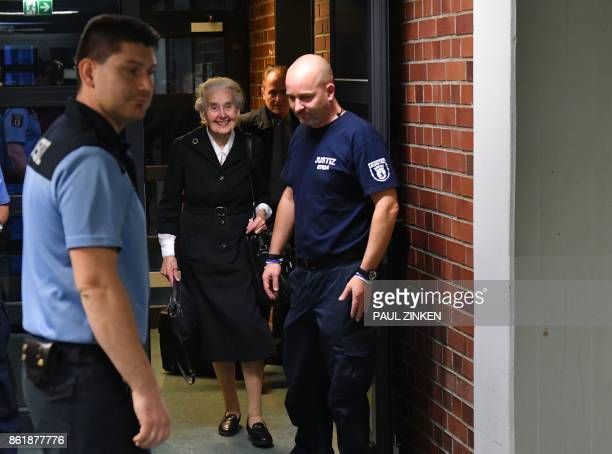 TOPSHOT Defendant Ursula Haverbeck arrives for the opening of her trial at court in Berlin on October 16 2017 The 88yearsold notorious Holocaust...