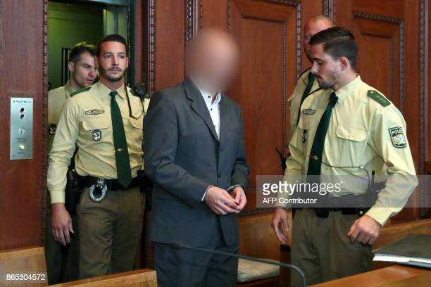 Defendant Wolfgang P arrives for the beginning of the trial in the district court in Nuremberg southern Germany on October 23 2017 The German...