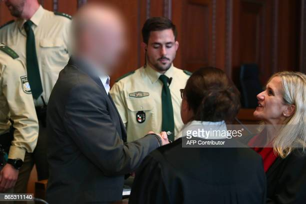 Defendant Wolfgang P shakes hands with his lawyer Susanne Koller ahead the beginning of the trial in the district court in Nuremberg southern Germany...
