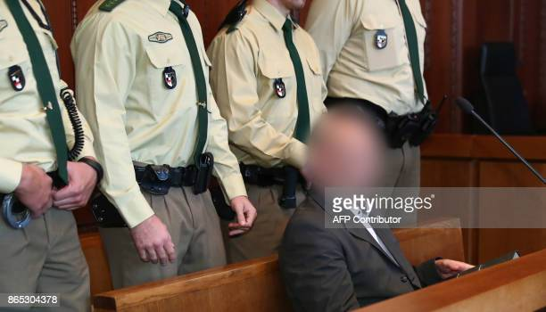 Defendant Wolfgang P sits on the bench ahead the beginning of the trial in the district court in Nuremberg southern Germany on October 23 2017 The...