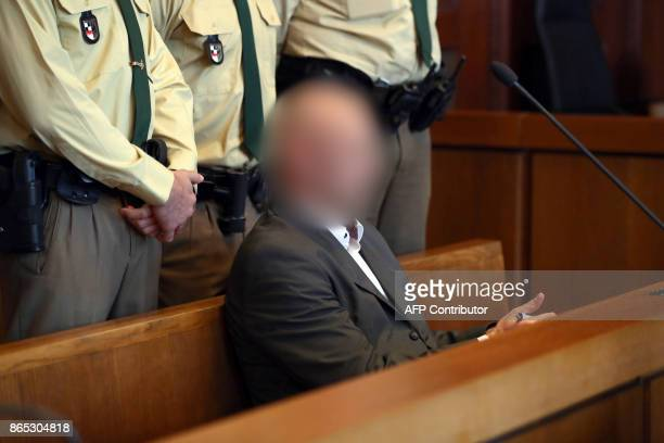 Defendant Wolfgang P waits for the beginning of the trial in the district court in Nuremberg southern Germany on October 23 2017 The German farright...