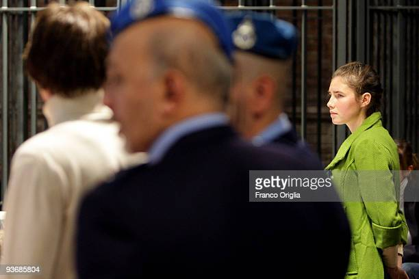 Defendants Amanda Knox and Raffaele Sollecito attend the Meredith Kercher murder trial for the closing arguments on December 3 2009 in Perugia Italy...