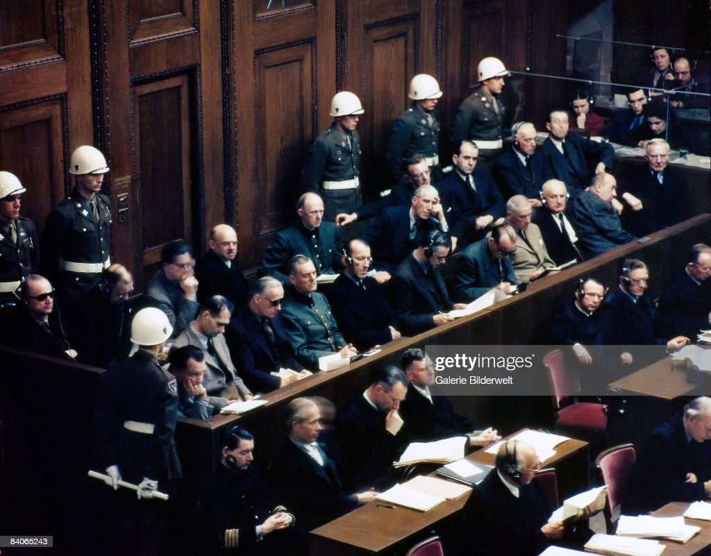 Defendants (in the two central rows) in the dock in Room 600 at the Palace of Justice, during proceedings against leading Nazi figures for war crimes at the International Military Tribunal (IMT), Nuremberg, Germany, 1946. Front row, left to right): Hermann Goering, Rudolf Hess, Joachim von Ribbentrop, Wilhelm Keitel, Alfred Rosenberg, Hans Frank, Wilhelm Frick, Julius Streicher, Walther Funk and Dr. Hjalmar Schacht. Back row, left to right): Karl Donitz, Erich Raeder, Baldur von Schirach, Fritz Sauckel, Alfred Jodl, Franz von Papen, Arthur Seyss-Inquart, Albert Speer, Konstantin von Neurath and Hans Fritzsche.