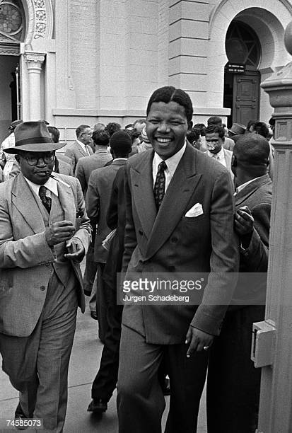 Defendants Moses Kotane and Nelson Mandela leave a courtroom in Pretoria South Africa during the Treason Trial 1958 The trial of 156 people lasted...