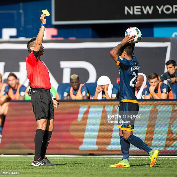 Defender A J DeLaGarza of Los Angeles Galaxy receives a yellow card during the match vs New York City FC at Yankee Stadium on August 20 2016 in New...