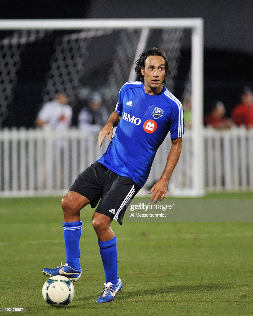 Defender <a gi-track='captionPersonalityLinkClicked' href=/galleries/search?phrase=Alessandro+Nesta&family=editorial&specificpeople=213983 ng-click='$event.stopPropagation()'>Alessandro Nesta</a> #14 of the Montreal Impact runs upfield against the Columbus Crew in the final round of the Disney Pro Soccer Classic on February 23, 2013 at the ESPN Wide World of Sports Complex in Orlando, Florida.
