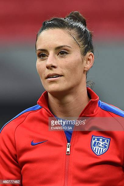 US defender Ali Krieger listens national anthems before a match during Brasilia International Tournament at the National Stadium Mane Garrincha in...