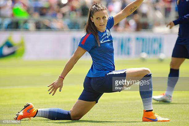 Defender Ali Krieger of the United States stretches before an international friendly match against Ireland on May 10 2015 at Avaya Stadium in San...