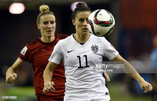 USA defender Ali Krieger vies with Germany's forward Anja Mittag during their 2015 FIFA Women's World Cup semifinal football match between USA and...