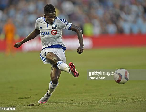 Defender Ambroise Oyongo of the Montreal Impact takes a shot on goal against Sporting Kansas City during the first half on July 18 2015 at Sporting...