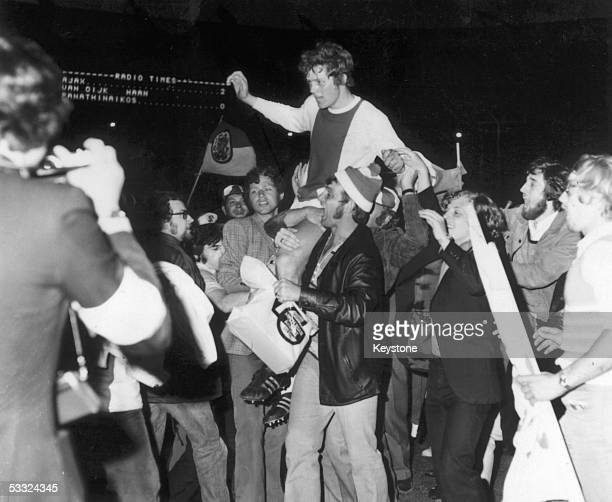Defender Arie Haan is carried from Wembley by jubilant Ajax fans after he scored to give his team a 20 victory over Greek team Panathinaikos in the...