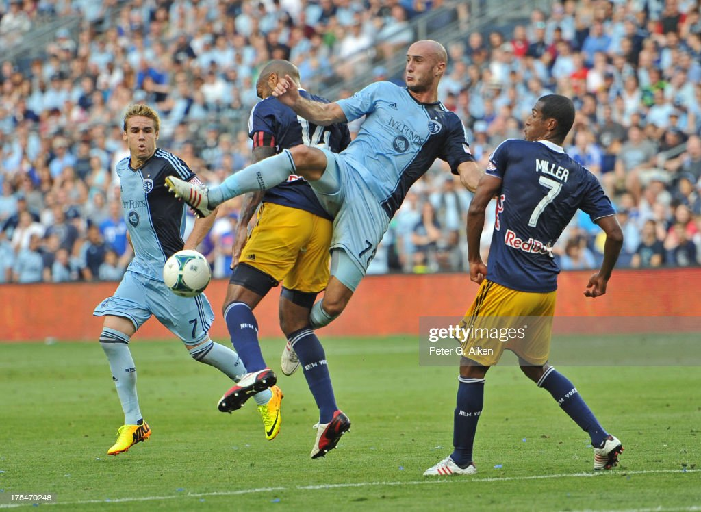 Defender Aurelien Collin #78 of Sporting Kansas City goes for the ball against pressure from forward <a gi-track='captionPersonalityLinkClicked' href=/galleries/search?phrase=Thierry+Henry&family=editorial&specificpeople=167275 ng-click='$event.stopPropagation()'>Thierry Henry</a> #14 of the New York Red Bulls during the second half on August 3, 2013 at Sporting Park in Kansas City, Kansas. New York defeated Kansas City 3-2.