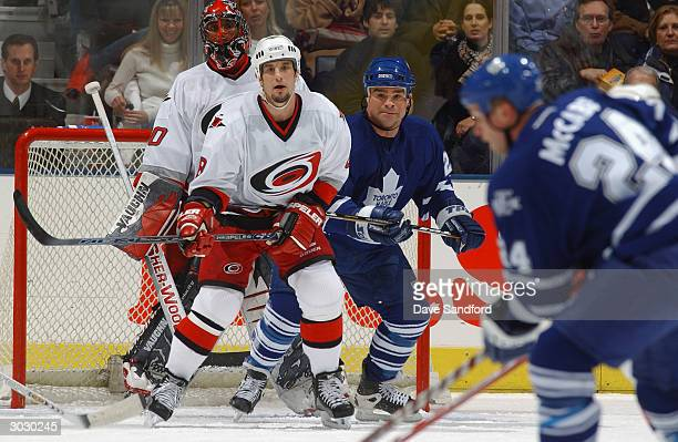 Defender Bob Boughner of the Carolina Hurricanes and his goalie Kevin Weekes protect the net from right wing Tie Domi and defenseman Bryan McCabe of...