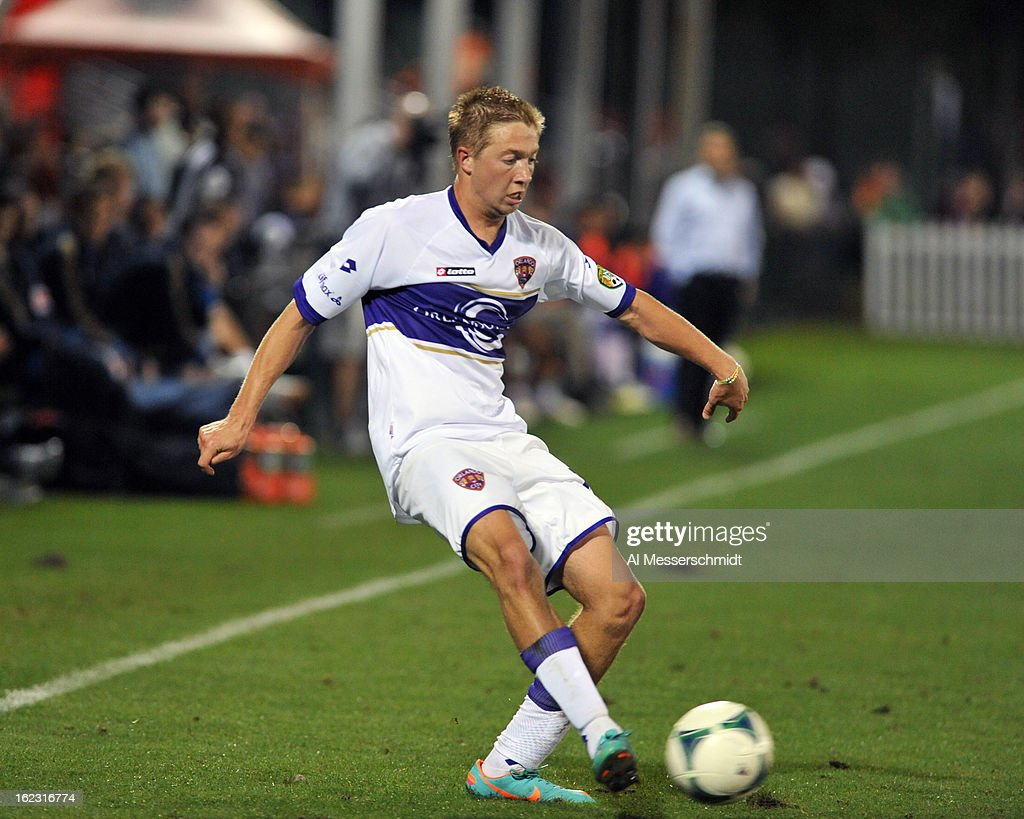 Defender <a gi-track='captionPersonalityLinkClicked' href=/galleries/search?phrase=Bryan+Burk&family=editorial&specificpeople=883587 ng-click='$event.stopPropagation()'>Bryan Burk</a>e #7 of Orlando City runs upfield against the Philadelphia Union February 9, 2013 in the first round of the Disney Pro Soccer Classic in Orlando, Florida. The match ended in a 1 - 1 tie.