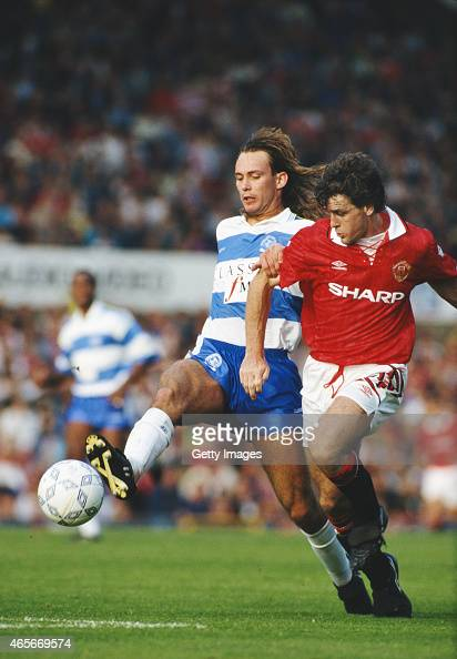 QPR defender Darren Peacock is challenged by Mark Hughes during a FA Premier League match between Manchester United and Queens Park Rangers at Old...