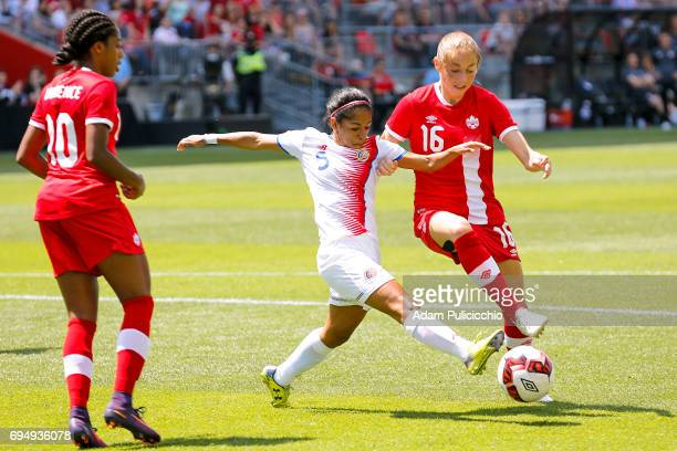 Defender Diana Sáenz of Team Costa Rica reaches for a loose ball against Forward Janine Beckie of Team Canada in a exhibition match on June 11 2017...