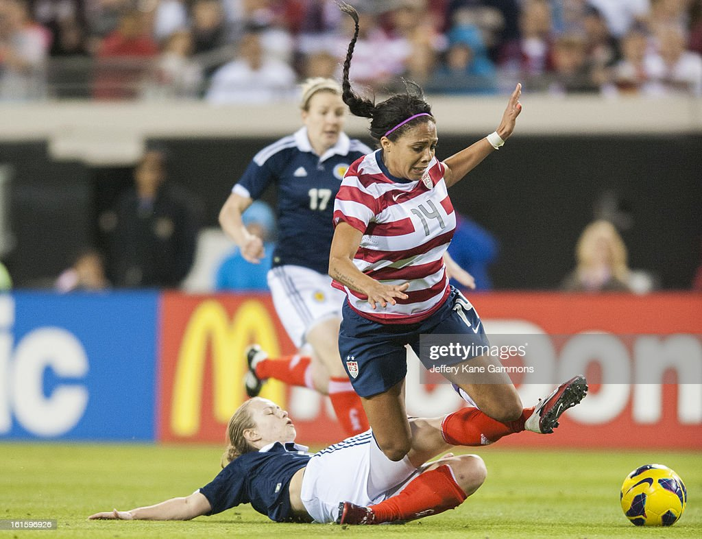 Defender Eilish McSorley #4 of Scotland tackles Forward Sydney Leroux #14 of the United States during the game at EverBank Field on February 9, 2013 in Jacksonville, Florida.
