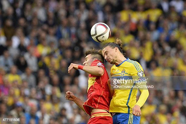 Defender Erik Johansson of Sweden vies with defender Marko Simic of Montenegro during the Euro 2016 Group G qualifying football match Sweden vs...