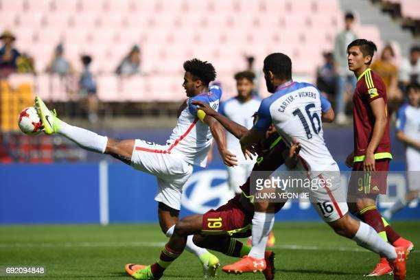 US defender Erik PalmerBrown reaches for the ball ahead of Venezuela's forward Sergio Cordova as US defender Cameron CarterVickers and Venezuela's...