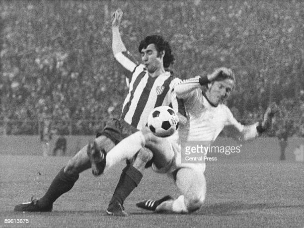 A defender from FC Bayern Munich tackles an Atletico Madrid player during the replay of the final of the European Cup at the Heysel Stadium in...