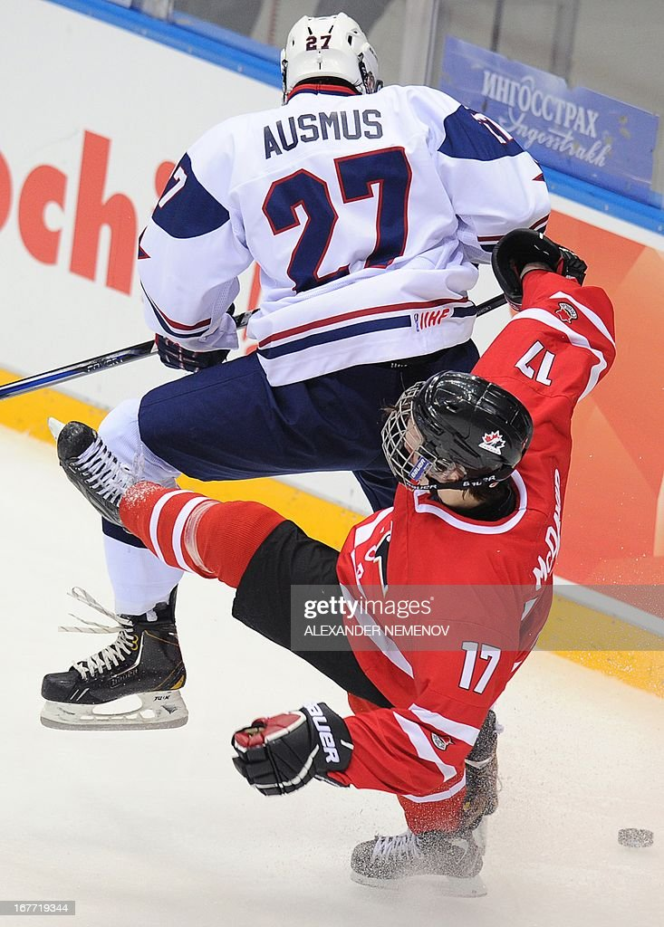 US defender Gage Ausmus (up) vies with Canada's forward Connor McDavid during the IIHF U18 International Ice Hockey World Championships final game in Sochi on April 28, 2013.