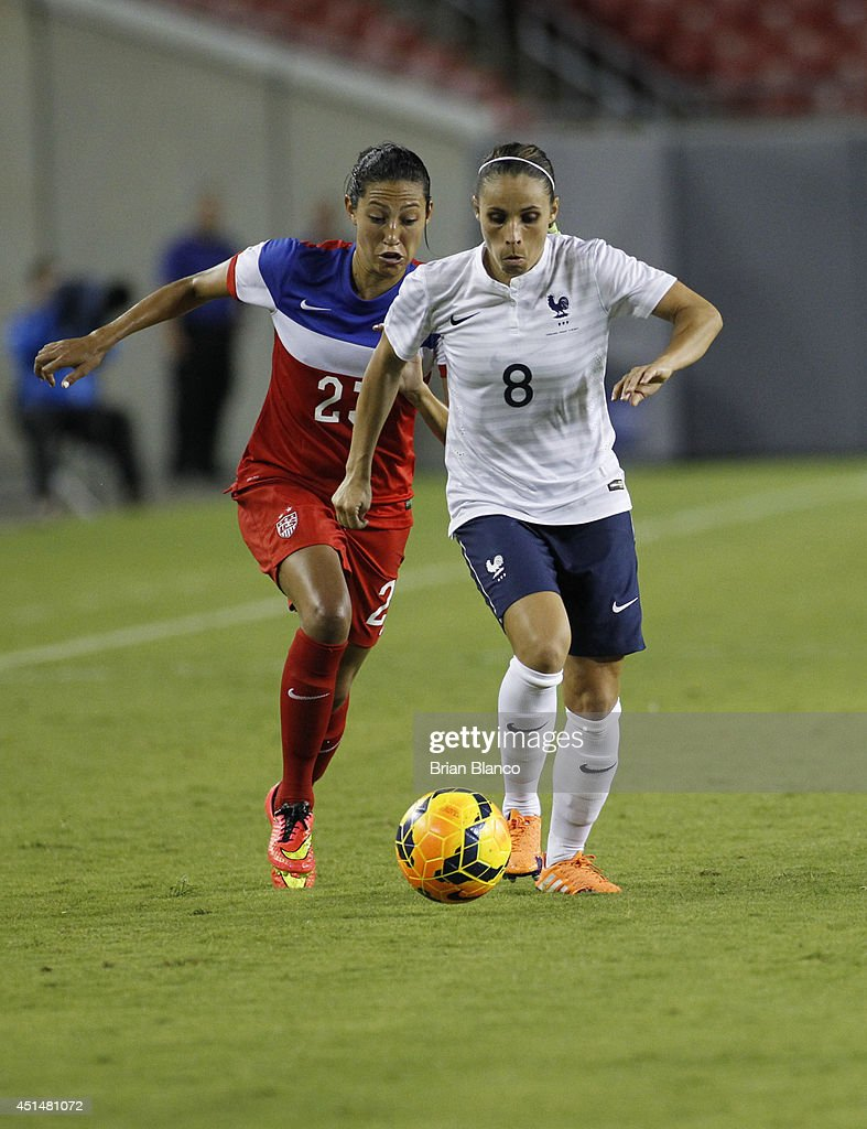 Defender <a gi-track='captionPersonalityLinkClicked' href=/galleries/search?phrase=Jessica+Houara&family=editorial&specificpeople=6380286 ng-click='$event.stopPropagation()'>Jessica Houara</a> #8 of France and forward <a gi-track='captionPersonalityLinkClicked' href=/galleries/search?phrase=Christen+Press&family=editorial&specificpeople=9019492 ng-click='$event.stopPropagation()'>Christen Press</a> #23 of the United States in action during the second half of a women's friendly soccer match on June 14, 2014 at Raymond James Stadium in Tampa, Florida.
