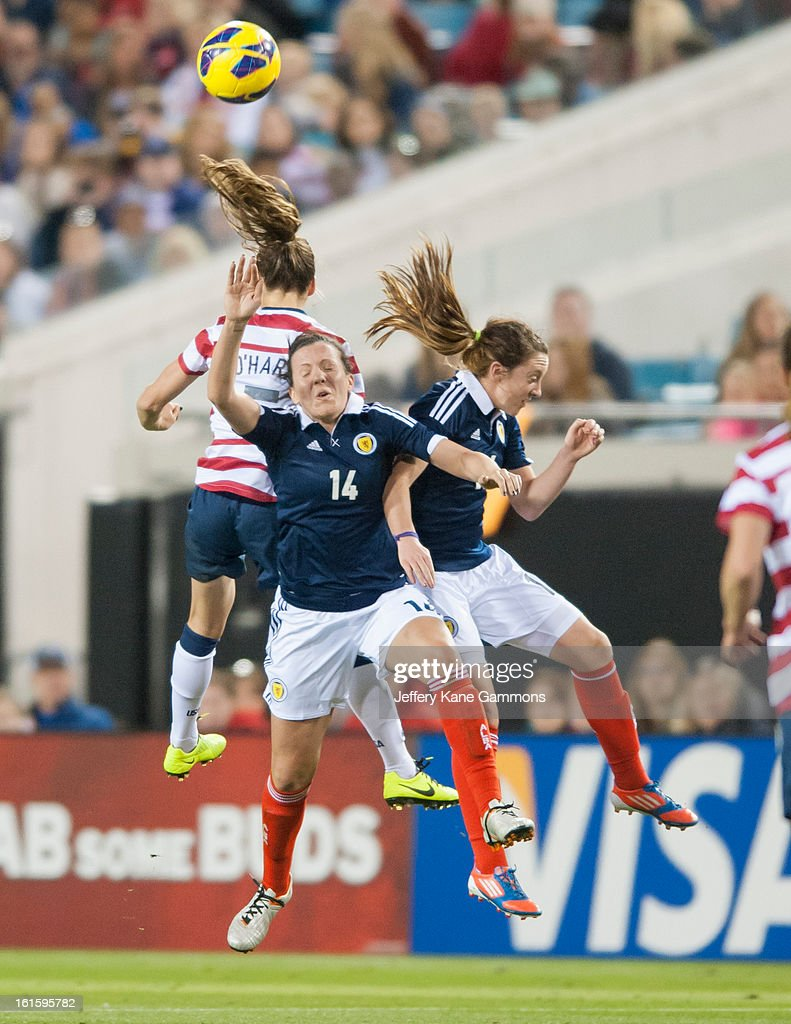 Defender Kelley O'Hara #5 of the United States and Midfielder Leanne Crichton #14 of Scotland go up to head the ball during the game at EverBank Field on February 9, 2013 in Jacksonville, Florida.