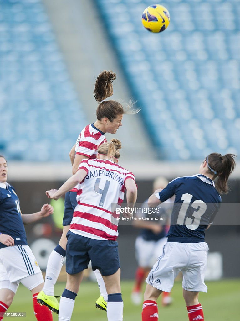 Defender Kelley O'Hara #5 of the United States heads the ball during the game against Scotland at EverBank Field on February 9, 2013 in Jacksonville, Florida.